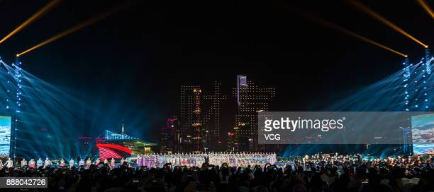 Guests watch performance during a welcoming banquet around Canton Tower on day two of the 2017 Fortune Global Forum on December 7 2017 in Guangzhou...
