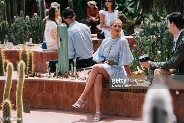 Guests watch the Arid Garden Runway as part of Melbourne Fashion Week on November 24, 2020 in Melbourne, Australia.