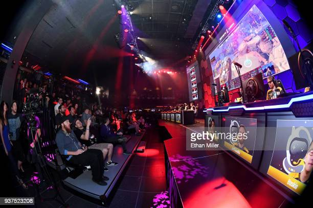 Guests watch the eUnited and Spacestation Gaming esport teams play in a Smite video game competition during the grand opening of Esports Arena Las...