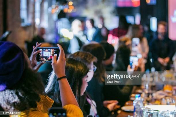 Guests watch the premiere of Miracle Workers on January 26 2019 in Park City Utah