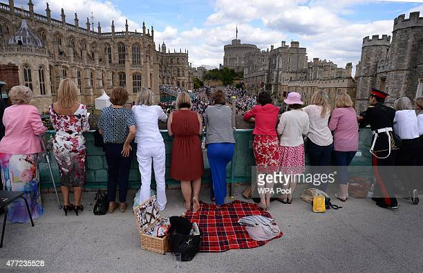 Guests watch the royal family leaving after the Order of the Garter Service at St George's Chapel in Windsor Castle on June 15 2015 in Windsor...