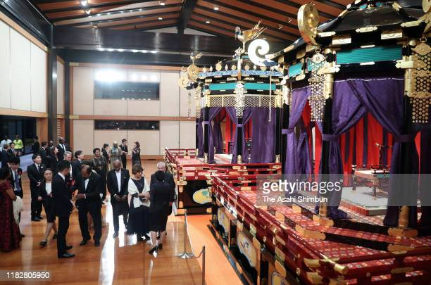 Guests watch the 'Takamikura' throne prior to the court banquet after the enthronement ceremony of Japanese Emperor Naruhito proclaiming his...