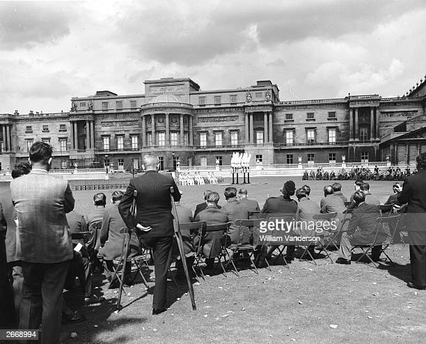 Guests watching a display performed by the Army School of Physical Training at a garden party at Buckingham Palace London organised by the Not...