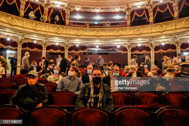Guests wear protective face masks and practice social distance as they watch the first performance inside the Juliusz Slowacki Theatre after the...
