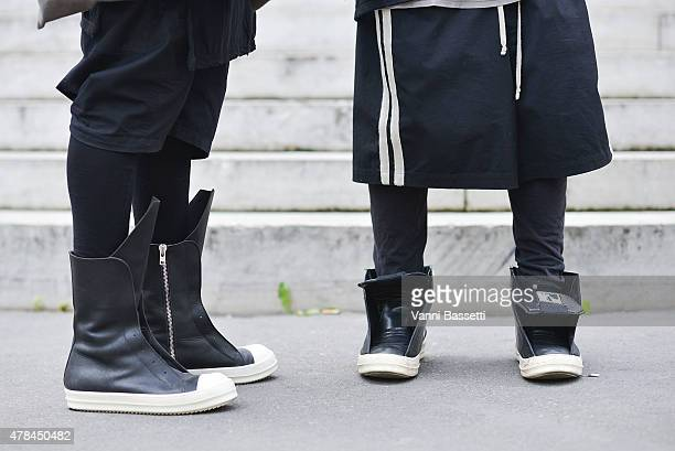 Guests wear Rick Owens shoes before the Rick Owens show on June 25 2015 in Paris France