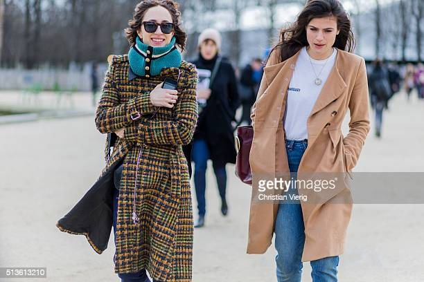 Guests wearing a plaid coat and turtleneck and denim jeans and white shirt outside Carven during the Paris Fashion Week Womenswear Fall/Winter...