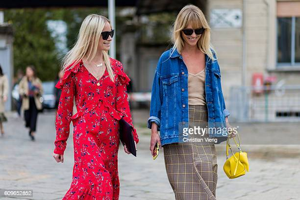 Guests wearing a red dress and denim jacket is seen outside Gucci during Milan Fashion Week Spring/Summer 2017 on September 21 2016 in Milan Italy