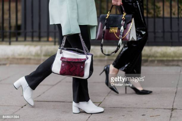 Guests wearing bags outside Anya Hindmarch during London Fashion Week September 2017 on September 17 2017 in London England