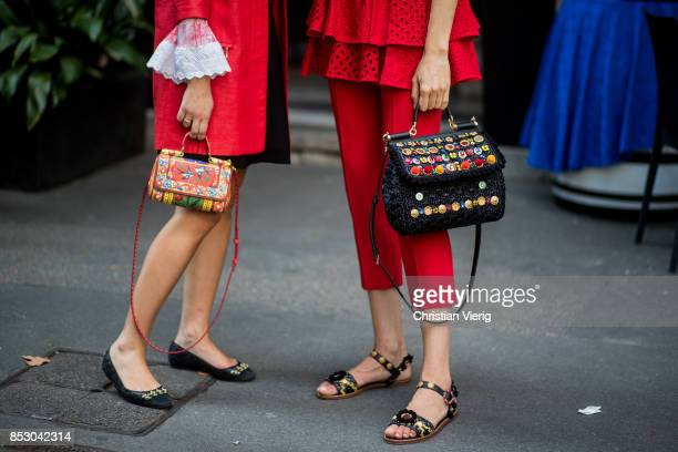 Guests wearing bags seen outside Dolce Gabbana during Milan Fashion Week Spring/Summer 2018 on September 24 2017 in Milan Italy