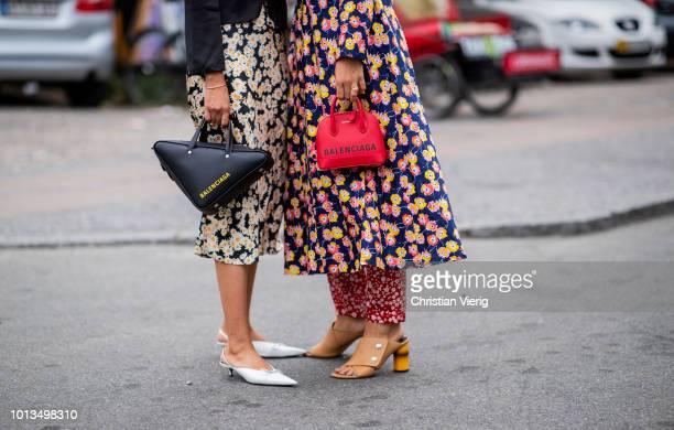 Guests wearing Balenciaga bag seen outside Stine Goya during the Copenhagen Fashion Week Spring/Summer 2019 on August 8 2018 in Copenhagen Denmark