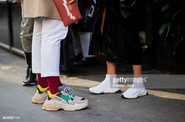 Guests wearing Balenciaga sneakers seen outside Dolce Gabbana during Milan Men's Fashion Week Fall/Winter 2018/19 on January 13 2018 in Milan Italy