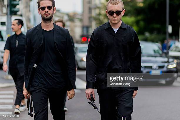 Guests wearing black blazer pants and button shirt outside Neil Barrett during the Milan Men's Fashion Week Spring/Summer 2017 on June 18 2016 in...