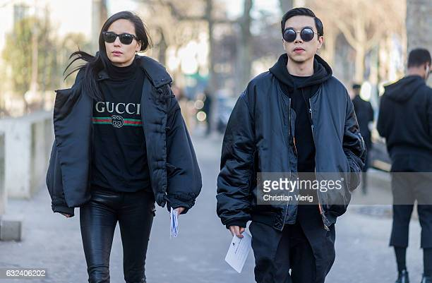 Guests wearing black jacket bomber jacket Gucci shirt leather pants jogger pants outside Lanvin on January 22 2017 in Paris France