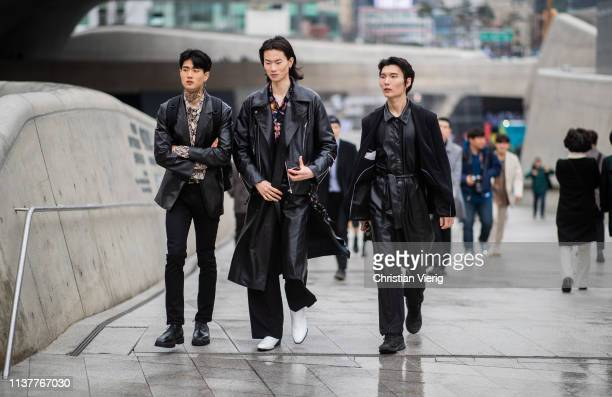 Guests wearing black leather coat overall at the Hera Seoul Fashion Week 2019 F/W at Dongdaemun Design Plaza at Dongdaemun Design Plaza on March 23...