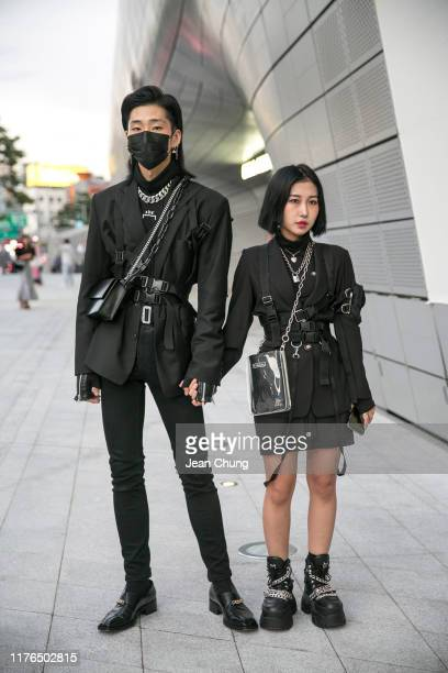 Guests wearing black outfit and Naked Wolf boots are seen during the Seoul Fashion Week 2020 S/S at Dongdaemun Design Plaza on October 18, 2019 in...