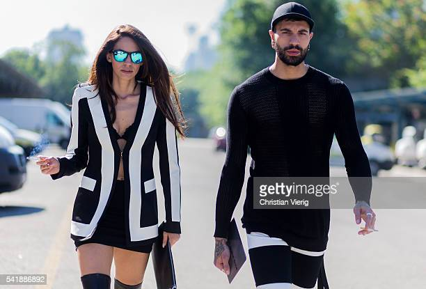Guests wearing black sweater and shorts and black white striped jacket and mini skirt by Hood By Air outside Diesel during the Milan Men's Fashion...