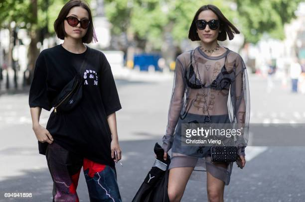 Guests wearing black tshirt sheer top belt bag bra during the London Fashion Week Men's June 2017 collections on June 11 2017 in London England