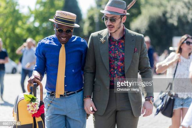 Guests wearing blue button shirt yellow tie olive suit and hat is seen during Pitti Immagine Uomo 92 at Fortezza Da Basso on June 13 2017 in Florence...