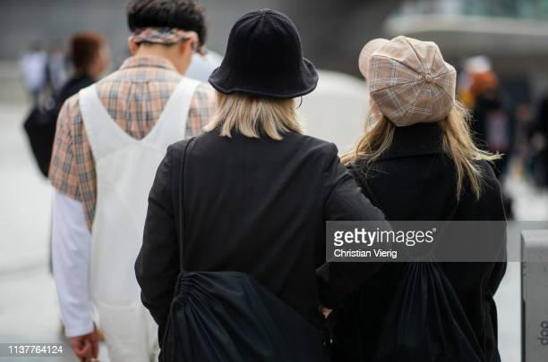 Guests wearing Burberry button shirt bandana white overall bucket hat and flat cap seen at the Hera Seoul Fashion Week 2019 F/W at Dongdaemun Design...