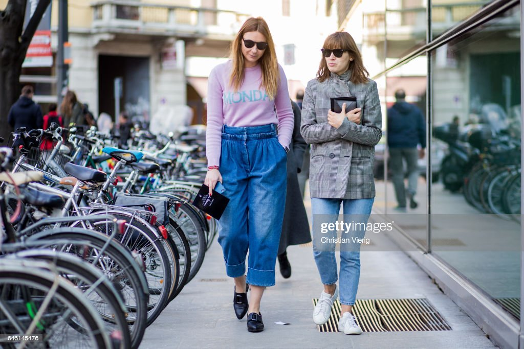 Guests wearing denim jeans, pink sweater outside Armani during Milan Fashion Week Fall/Winter 2017/18 on February 27, 2017 in Milan, Italy.