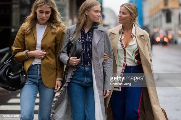 Guests wearing denim trench coat Loewe bag outside Bik Bok Runway Award on August 24 2017 in Oslo Norway