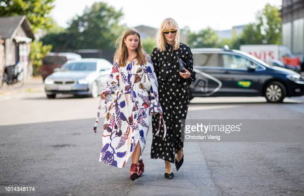 Guests wearing dress with graphic print seen outside Ganni during the Copenhagen Fashion Week Spring/Summer 2019 on August 9 2018 in Copenhagen...