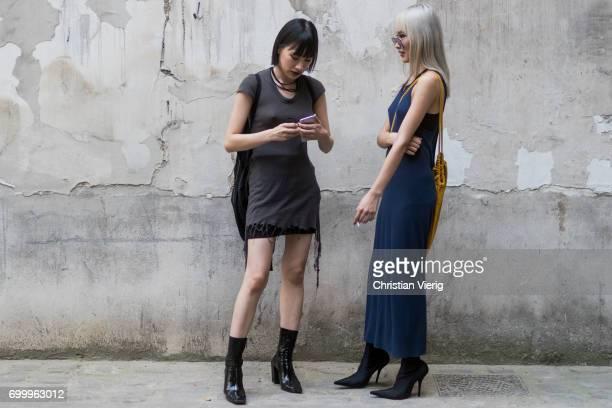 Guests wearing dresses outside Boris Bidjan Saberi during Paris Fashion Week - Menswear Spring/Summer 2018 on June 22, 2017 in Paris, France.