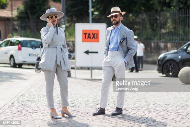 Guests wearing grey suit and hats t is seen during Pitti Immagine Uomo 92 at Fortezza Da Basso on June 14 2017 in Florence Italy