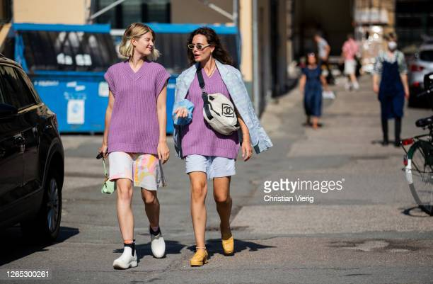 Guests wearing Keiko vest 11250, shorts are seen outside Samsøe & Samsøe during Copenhagen Fashion Week Spring/Summer 2021 on August 11, 2020 in...