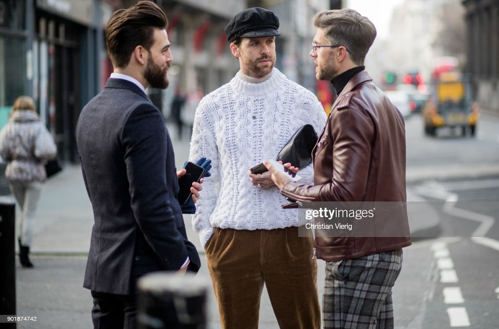 Guests wearing knit, flat cap during London Fashion Week Men's January 2018 on January 6, 2018 in London, England.