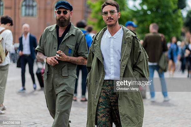 Guests wearing military parka and jumpsuit during Pitti Uomo 90 on June 14 in Florence Italy