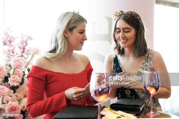 Guests wearing Mimco headpiece and Christopher Esber dress at Moet Chandon Spring Champion Stakes Day at Royal Randwick Racecourse on October 7 2017...