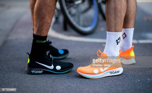 Guests wearing OffWhite x Nike Foam sneakers is seen outside Palm Angels during Milan Men's Fashion Week Spring/Summer 2019 on June 17 2018 in Milan...
