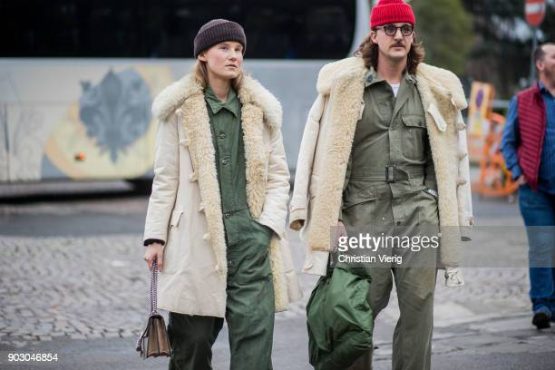Guests wearing olive overall teddy coat is seen during the 93 Pitti Immagine Uomo at Fortezza Da Basso on January 9 2018 in Florence Italy