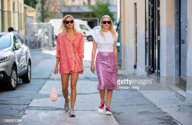 Guests wearing oversized red white striped shirt, pink skirt, white shirt are seen outside Samsøe & Samsøe during Copenhagen Fashion Week...