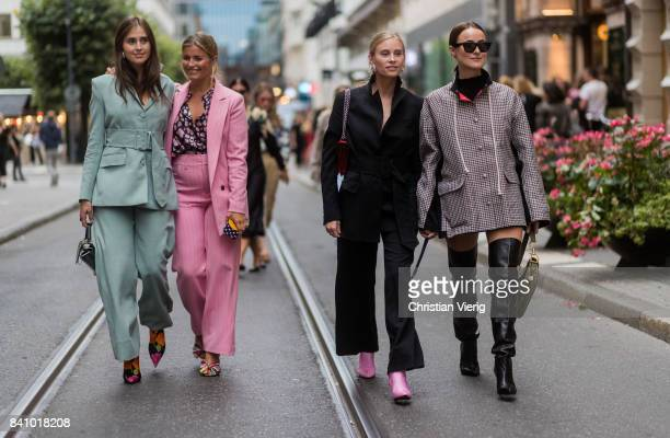 Guests wearing pastel suit pink suit outside Rodebjer on August 30 2017 in Stockholm Sweden