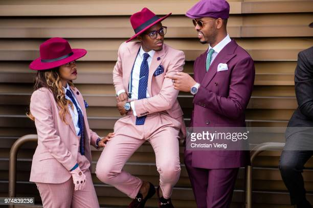 Guests wearing pink and purple suit flat cap red hat seen during the 94th Pitti Immagine Uomo on June 14 2018 in Florence Italy