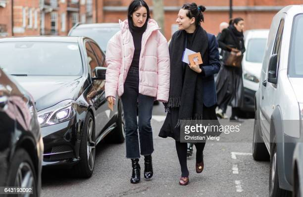 Guests wearing pink down feather jacket outside Anya Hindmarch on day 3 of the London Fashion Week February 2017 collections on February 19 2017 in...