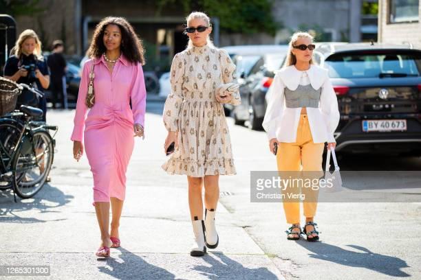 Guests wearing pink dress, yellow trousers, white blouse, drey bustier are seen outside Samsøe & Samsøe during Copenhagen Fashion Week Spring/Summer...