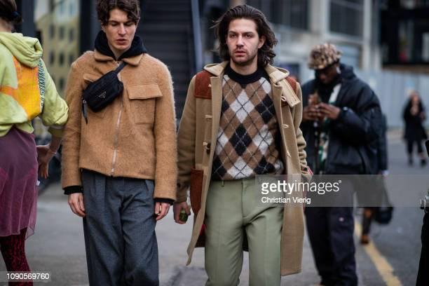Guests wearing Prada belt bag seen during London Fashion Week Men's January 2019 on January 06 2019 in London England