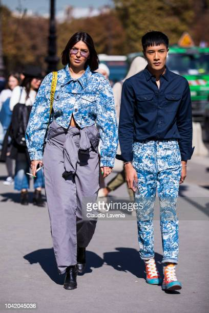 Guests wearing printed jacket and grey pants and blue shirt and printed pants with colorful sneakers are seen before the Paco Rabanne show on...