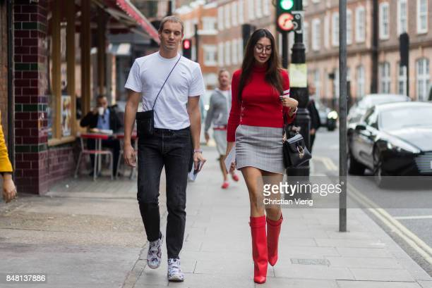 Guests wearing red knit grey mini skirt outside JW Anderson during London Fashion Week September 2017 on September 16 2017 in London England