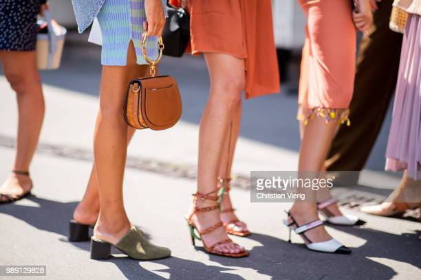 Guests wearing sandals mules Chloe bag seen outside Acne Studios during Paris Fashion Week Haute Couture FW18 on July 1 2018 in Paris France