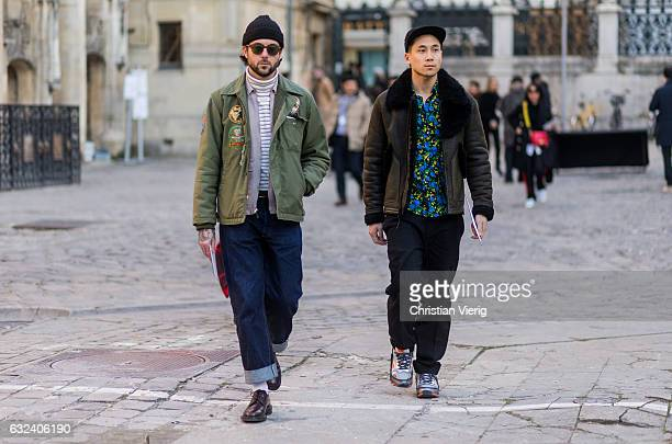Guests wearing sheepskin jacket, beanie outside Paul Smith on January 22, 2017 in Paris, France.