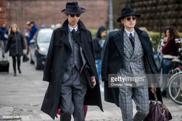 Guests wearing suits black hats wool coat seen during the 93 Pitti Immagine Uomo at Fortezza Da Basso on January 9 2018 in Florence Italy