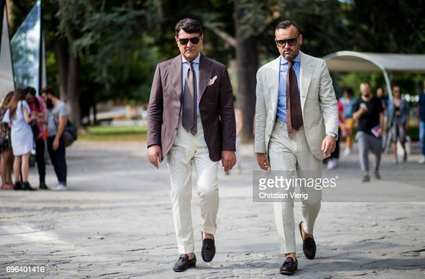 Guests wearing suits is seen during Pitti Immagine Uomo 92 at Fortezza Da Basso on June 15 2017 in Florence Italy
