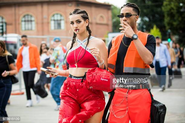 Guests wearing Tommy Hilfiger top Supreme underwear and red pant and orange vest Supreme underwear and orange pants are seen during the 94th Pitti...