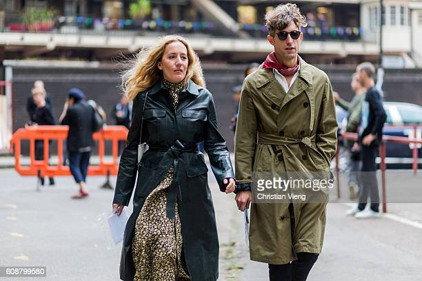 Guests wearing trench coats outside Joseph during London Fashion Week Spring/Summer collections 2017 on September 19 2016 in London United Kingdom