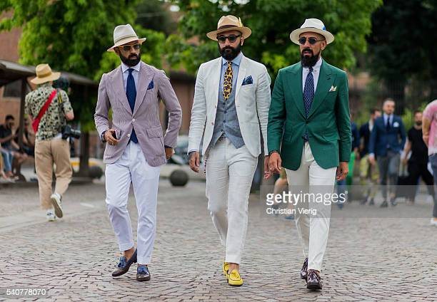 Guests wearing white pants and blazer during Pitti Uomo 90 on June 16 in Florence Italy
