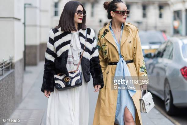 Guests wearing wide leg pants Gucci bag Gucci glasses mustard coat Bulgari bag outside Julien Macdonald on day 2 of the London Fashion Week February...